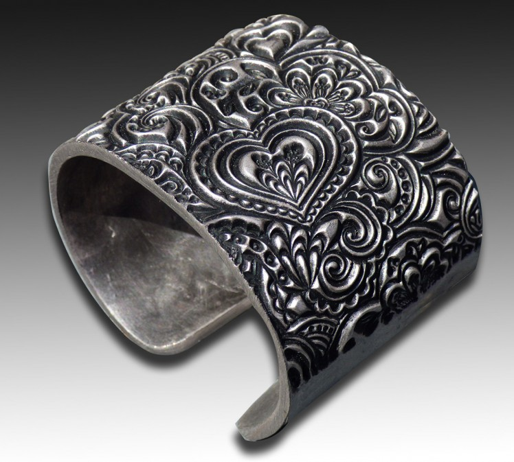 Adriana Allen https://www.etsy.com/listing/225407533/hearts-zentangle-polymer-clay-cuff